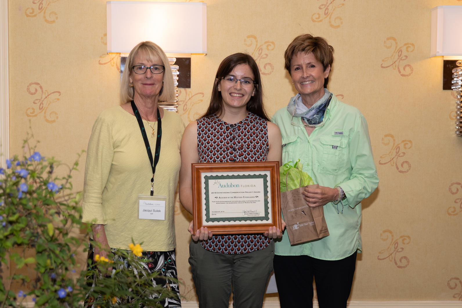 Photographer Jean Hall and Biologist Allison Smith accepted the award.