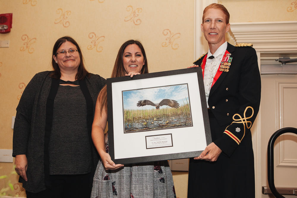 Lt. Col. Jennifer Reynolds accepting the Champion of the Everglades.
