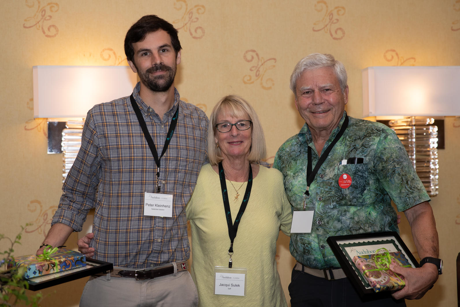 Two Audubon chapter leaders accept the award for being extraordinary leaders.
